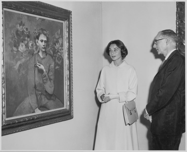 Audrey Hepburn and Alfred H. Barr, Jr. at the exhibition 'Picasso: 75th Anniversary,' on view May 4, 1957 through August 25, 1957 (first floor and auditorium); May 22, 1957 through September 8, 1957 (third floor) at The Museum of Modern Art, New York (photo by Barry Kramer)